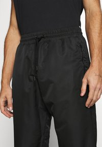 NU-IN - SHELL JOGGERS - Tracksuit bottoms - black - 5