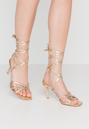 ANKLE STRAP STILETTO HEELS - High heeled sandals - gold