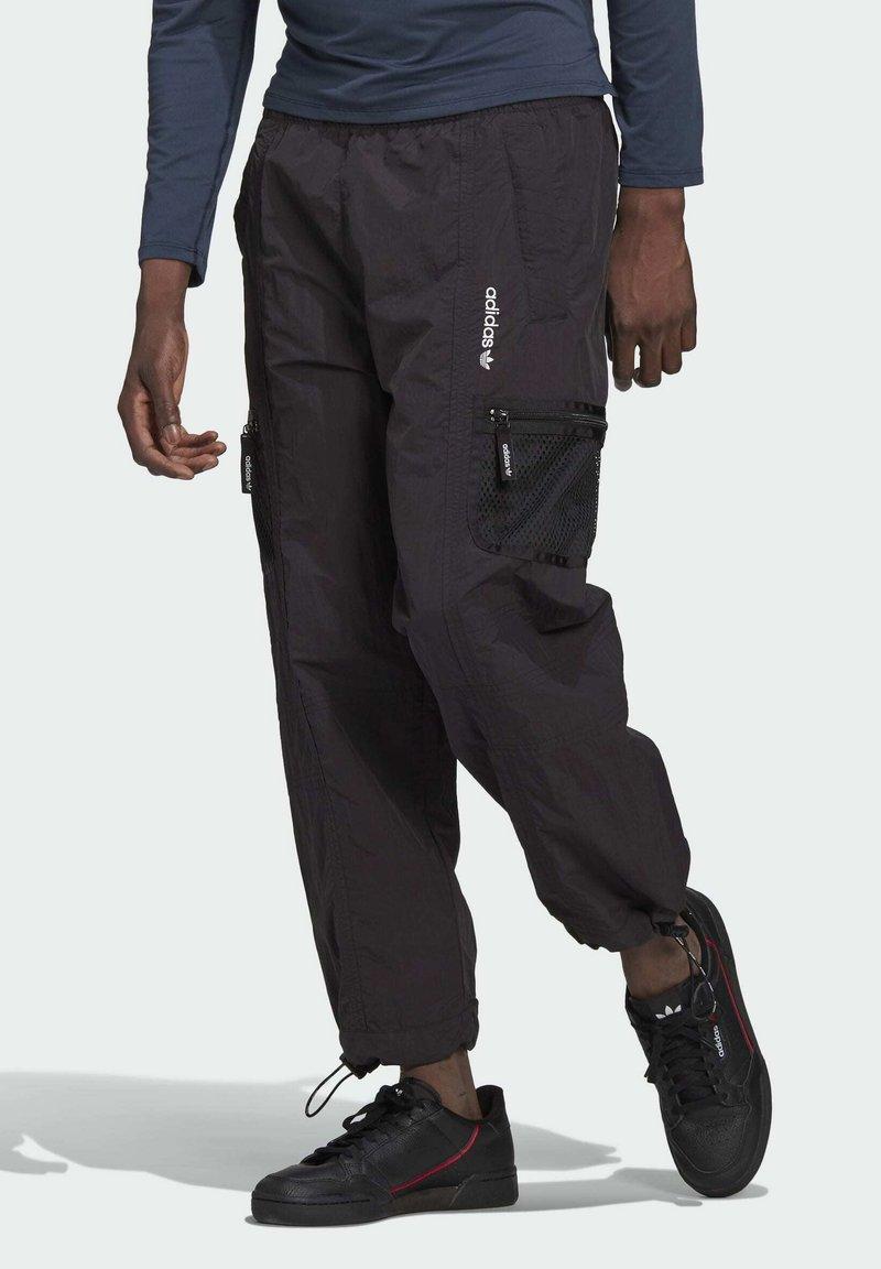 adidas Originals - ADV Woven PANTS ADVENTURE ORIGINALS REGULAR TRACK - Tracksuit bottoms - black
