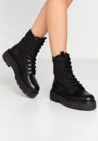 Tommy Jeans - FLATFORM BOOT - Platform ankle boots - black - 0