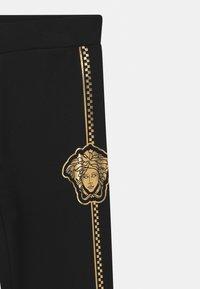 Versace - BOTTOM FELPA UNISEX - Tracksuit bottoms - nero - 2