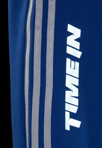 adidas Originals - NINJA PANT UNISEX - Tracksuit bottoms - blue - 7
