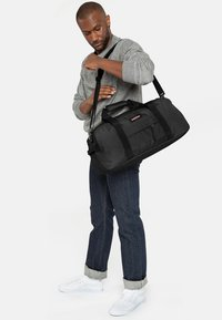Eastpak - STAND + CORE COLORS  - Holdall - black - 1