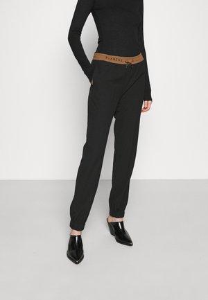 LORA PANTS - Spodnie treningowe - black
