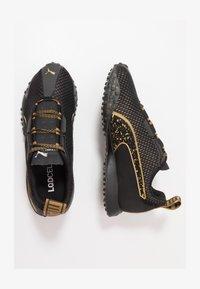 METAL WN'S - Neutral running shoes - black/metallic gold