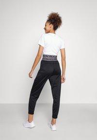 Calvin Klein Performance - PANT - Pantalon de survêtement - black - 2