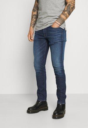 SLIM TAPER - Zúžené džíny - blue