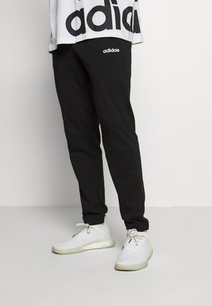 ESSENTIALS SPORTS REGULAR PANTS - Spodnie treningowe - black