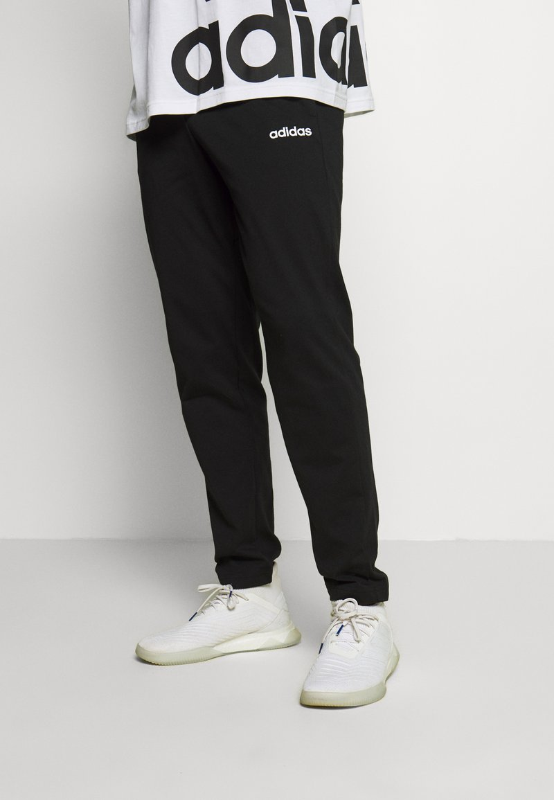 adidas Performance - ESSENTIALS SPORTS REGULAR PANTS - Tracksuit bottoms - black