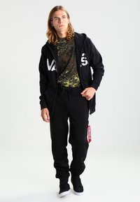 Alpha Industries - FIT PANT - Träningsbyxor - black - 1