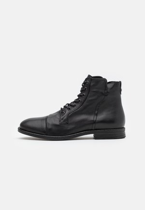 STEURSTRAAT - Lace-up ankle boots - black