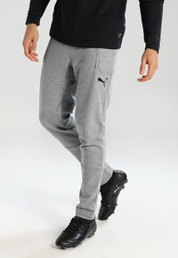 Puma - LIGA CASUALS PANTS - Pantalon de survêtement - medium gray heather/black - 0
