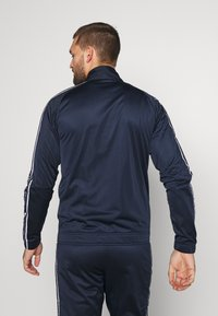 Champion - TRACKSUIT TAPE - Survêtement - navy - 2
