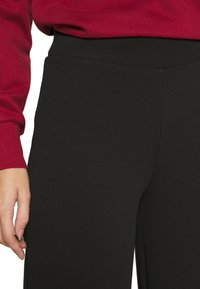 ONLY - ONYCOCO ROCKY WIDE PANT  - Trousers - black - 4