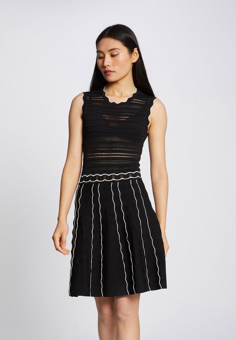 Morgan - Jumper dress - black