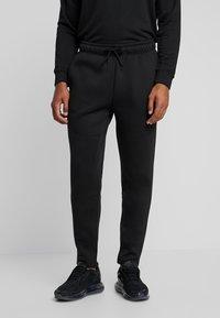 Urban Classics - CUT AND SEW PANTS - Tracksuit bottoms - black - 0