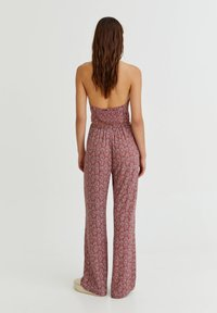 PULL&BEAR - MIT PRINT - Trousers - red - 2