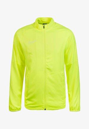 DRY ACADEMY - Träningsjacka - neon yellow