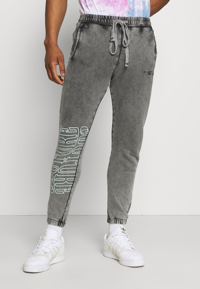 COUTURE WAVE PRINT RELAXED JOGGER - Pantaloni sportivi - grey acid wash