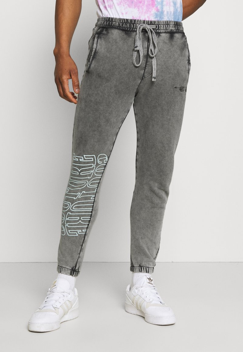 The Couture Club - COUTURE WAVE PRINT RELAXED JOGGER - Tracksuit bottoms - grey acid wash