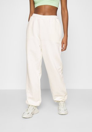 NA-KD X ZALANDO EXCLUSIVE - LOOSE FIT PANTS - Tracksuit bottoms - off-white