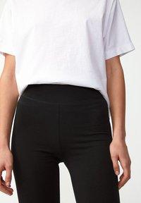 ARMEDANGELS - FARIBAA - Leggings - Trousers - black - 3