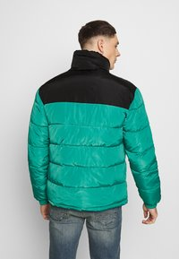 Karl Kani - BLOCK REVERSIBLE PUFFER JACKET - Winter jacket - turquoise - 2