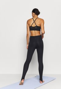 Nike Performance - YOGA CORE CUTOUT 7/8 - Leggings - black/dark smoke grey - 2
