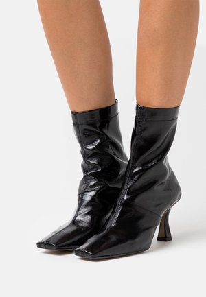 VEGAN VIVA FLARED BOOT - High heeled ankle boots - black