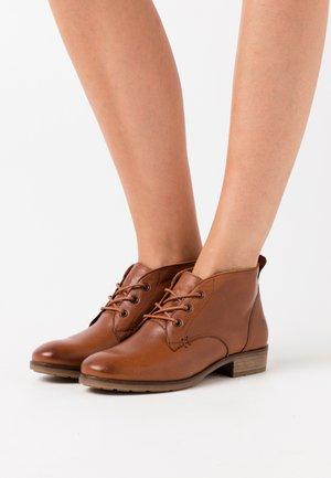 BRUNA - Ankle boots - cognac
