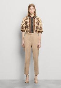 sandro - FEYNE - Trousers - beige - 1