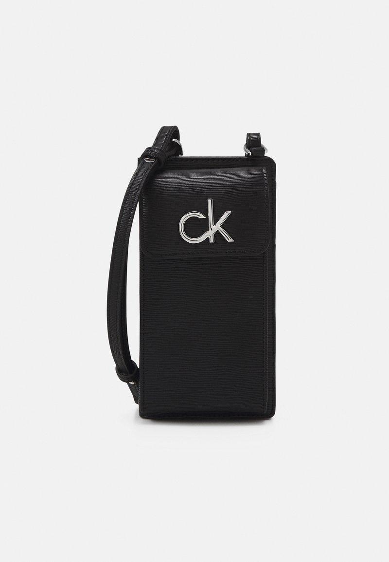 Calvin Klein - PHONE XBODY POUCH - Across body bag - black