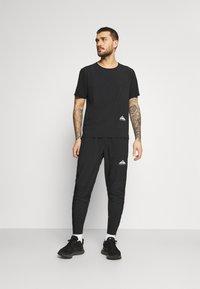 Nike Performance - ELITE PANT TRAIL - Pantalones deportivos - black/white - 1