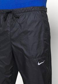 Nike Performance - SHIELD - Tracksuit bottoms - black/reflective silver - 4
