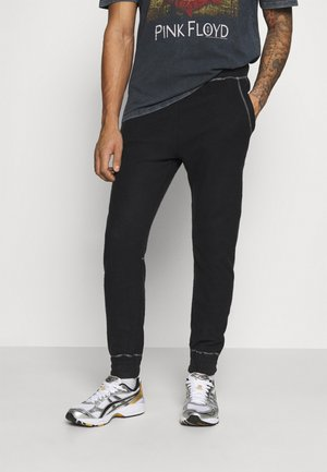 CONTRAST STITCH JOGGER UNISEX - Tracksuit bottoms - black