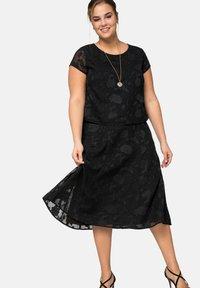 Sheego - A-line skirt - black - 4
