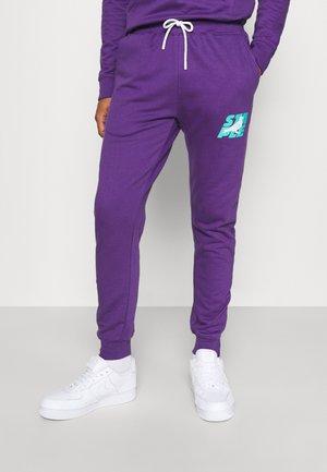 STACKED LOGO - Donji dijelovi trenirke - purple