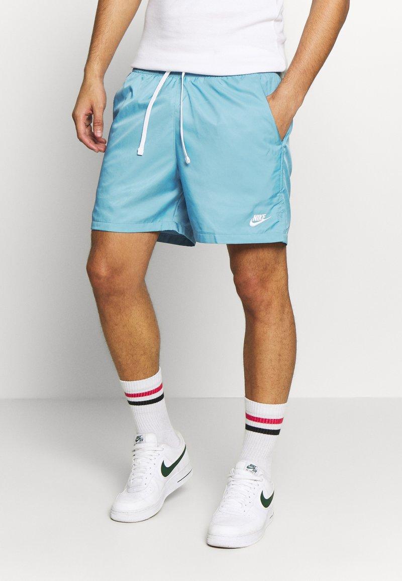Nike Sportswear - FLOW - Shorts - cerulean/white