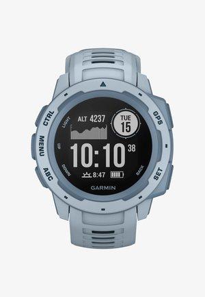 GPS-MULTISPORT-SMARTWATCH INSTINCT - Smartwatch - light blue
