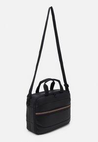 Tommy Hilfiger - HOUR BAG UNISEX - Across body bag - black - 1