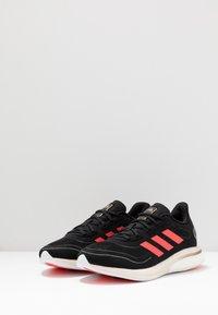 adidas Performance - SUPERNOVA - Neutral running shoes - core black/signal pink/copper metallic - 2
