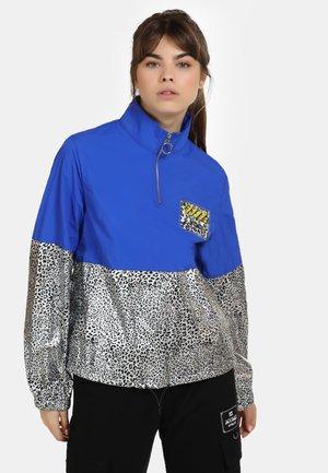 Lehká bunda - blau silber leo