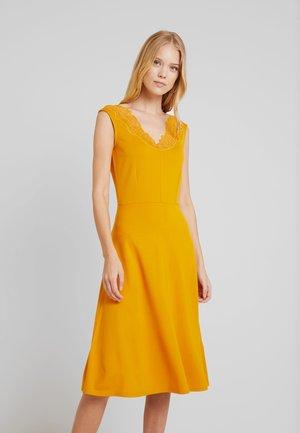 Etuikjole - golden yellow