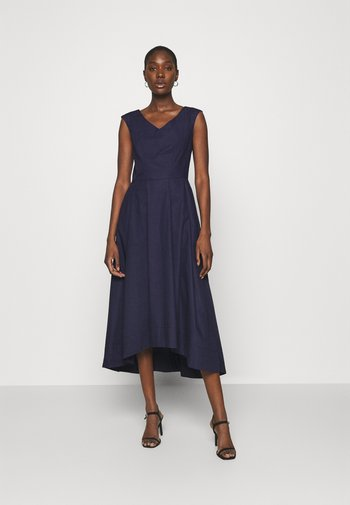 HIGH LOW PLEATED DRESS