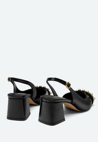 Uterqüe - Classic heels - black - 2