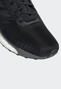 adidas Performance - SOLARBOOST 19 SHOES - Stabilty running shoes - black - 9