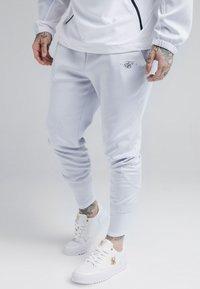 SIKSILK - TRANQUIL DUAL CUFF PANTS - Verryttelyhousut - light blue/white - 0