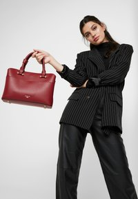 Dune London - DINIDARING SMALL UNLINED - Across body bag - oxblood red - 1