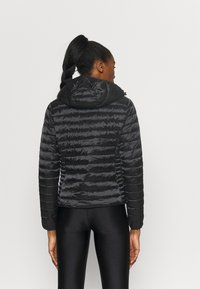 Champion - HOODED JACKET - Winter jacket - black - 2