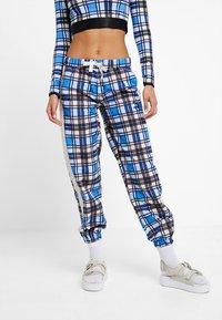 Puma - CHECK WIDE LEG PANTS - Trousers - strong blue - 0